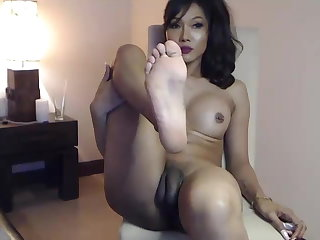 MILFs She is an Asian Ladyboy doing her thing on the webcam