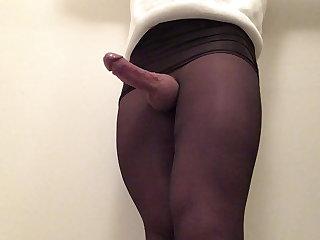 Big cock in black pantyhose .